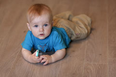 Baby is lying on the floor Royalty Free Stock Image