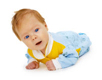 Baby lying on floor Royalty Free Stock Photos