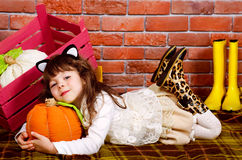 Baby lying on the floor. Hugging a pumpkin Stock Photography