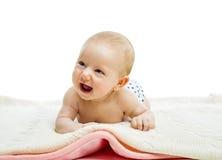 Baby lying on a floor Stock Photos