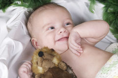 Baby lying with fury toy Royalty Free Stock Images
