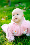 Baby lying on grass. And looking up royalty free stock image