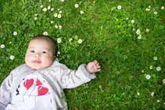 Baby lying on grass Royalty Free Stock Photos