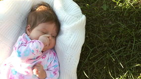 Baby lying on the grass stock video