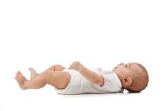 Baby lying on her back stock photo
