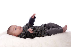 Baby lying on his back looking up Royalty Free Stock Photography