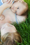 Baby lying on mummy shoulder Royalty Free Stock Image