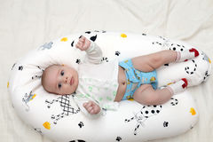 Baby lying on pillow Stock Image