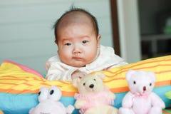 Baby lying prone Stock Photos