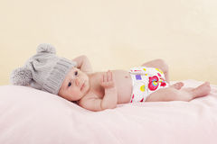 Baby lying and relaxing. Stock Photos