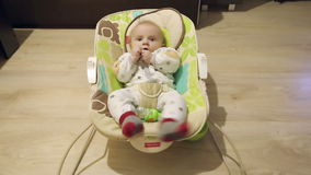 Baby lying in rocking chair. stock footage