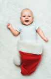 Baby is lying in the Santa's hat Stock Photo