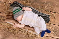 Baby lying on a scarf. Top view of little kid Royalty Free Stock Image
