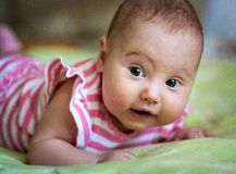 Baby lying and smiling. Beautiful baby in bright clothes lying and smiling Royalty Free Stock Images