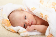 Baby lying on soft cover. Royalty Free Stock Photos