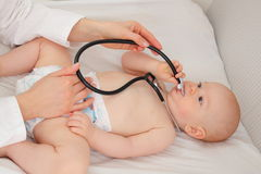 Baby at madical checkup with stethoscope Royalty Free Stock Images