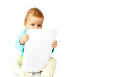 Baby and magazine. On white royalty free stock photography