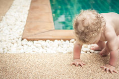 Baby making efforts to get up with copy space. Baby learning walking making efforts to get up stock photos