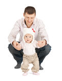 Baby making first steps with father help Royalty Free Stock Image