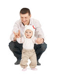 Baby making first steps with father help. Picture of baby making first steps with father help royalty free stock photo