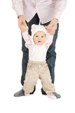 Baby making first steps with father help. Picture of baby making first steps with father help stock images