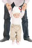 Baby making first steps with father help. Picture of baby making first steps with father help Royalty Free Stock Image