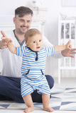 Baby making first steps with father Royalty Free Stock Photo