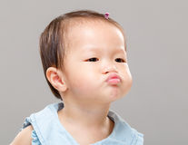 Baby making funny face Stock Photo