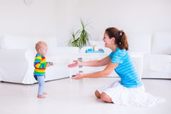 Baby making his first steps Stock Photography