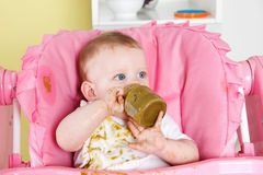 Baby making a mess while eating Royalty Free Stock Images