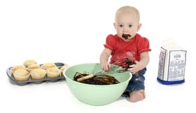 Baby Making Muffins Stock Image