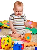 Baby making puzzle. Child jigsaw develops children. Stock Photo