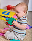 Baby making puzzle. Child jigsaw develops children. Stock Photography
