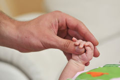 Baby and man hand touch. Little bayb and big father hands closeup Royalty Free Stock Images