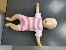 Resuscitation baby mannequin on a table. Baby mannequin ready for cardiopulmonary resuscitation on a table - open mouth stock images