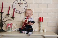 Baby on the mantelpiece Royalty Free Stock Photos