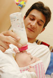 Baby Maria #62. Beautiful little baby and his father Stock Photo