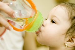 Baby Maria #70. Baby Maria drinking wather without her mother in backgroud stock images