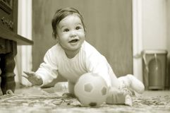Baby Maria #75. Little baby girl playing with her toys on the carpet stock image