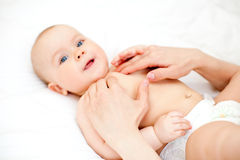 Baby massage Stock Image
