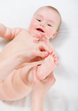Baby massage Stock Image