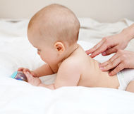 Baby massage royalty free stock photos