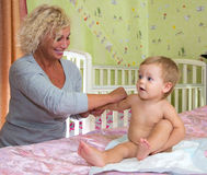 Baby massage at home. By professional masseur Royalty Free Stock Photo