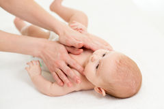 Baby massage. Mother massaging kid. Royalty Free Stock Photos