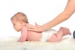 Baby massage. Spine Royalty Free Stock Image