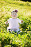 Baby on the meadow Stock Photography