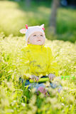 Baby on the meadow Stock Photos