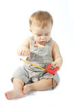Baby with a measuring tape Royalty Free Stock Photo