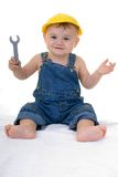 Baby mechanic. Baby mehanic holding wrensch, copy space left below stock images