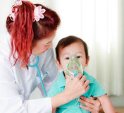 Baby and medical instrument Royalty Free Stock Photography